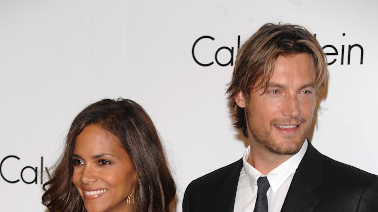 FILE - In this Sept. 7, 2008 file photo, Model Gabriel Aubry and actress Halle Berry attends the Calvin Klein 40th anniversary party during Fashion Week in New York. Berry's ex-boyfriend Aubry was arrested for investigation of battery after he and the Oscar-winning actress' current boyfriend got into a fight at her California home, police said Thursday, Nov. 22, 2012. (AP Photo/Peter Kramer, File)