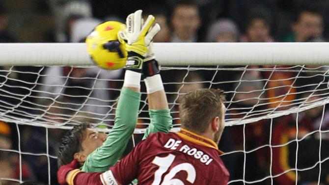 Cagliari goalkeeper Vlada Avramov, of Serbia, left, and AS Roma midfielder Daniele De Rossi jump for the ball during a Serie A soccer match between AS Roma and Cagliari, at Rome's Olympic stadium, Monday, Nov. 25, 2013