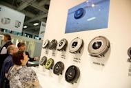 A group of 60+ visitors watch a range of domestic cleaning robots at a booth during the first day of the IFA trade fair in Berlin on August 31. High-tech gadgets to make the lives of senior citizens simpler, safer and more fun are in the spotlight at the world's top consumer electronics' and home appliances' showcase