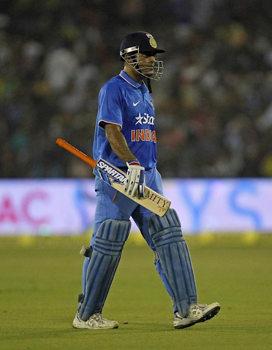 India's captain Mahendra Singh Dhoni walks off the field after being dismissed by South Africa's Albie Morkel during their second Twenty20 cricket match in Cuttack
