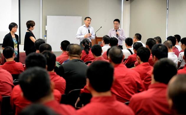 SMRT CEO Desmond Kuek speaking with about 100 bus drivers on Monday morning at his first townhall session. (Photo courtesy of SMRT)
