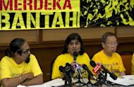 Ambiga Sreenevasan (centre), leader of electoral reform pressure group Bersih 2.0 speaks at a press conference in Kuala Lumpur. The activists have vowed to go ahead with a planned mass political rally on Saturday despite a crackdown by authorities who have sealed off a square in Kuala Lumpur and banned the protest