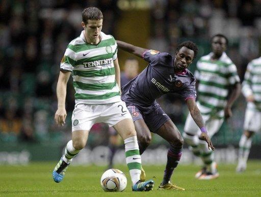 Celtic's Adam Matthews (L) escapes from Rennes' Jonathan Pitroipa during a Europa League game in November