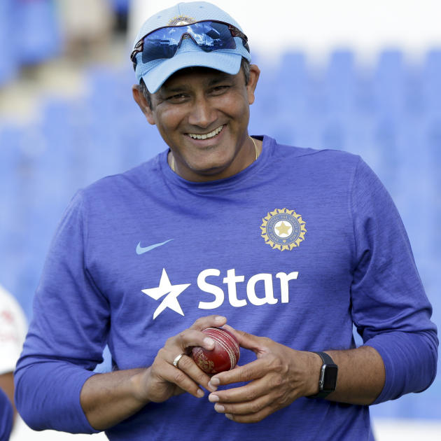 India's team head coach Anil Kumble smiles at the end of day four of the first cricket Test match against West Indies at the Sir Vivian Richards Stadium in North Sound, Antigua, Sunday, July 24, 2