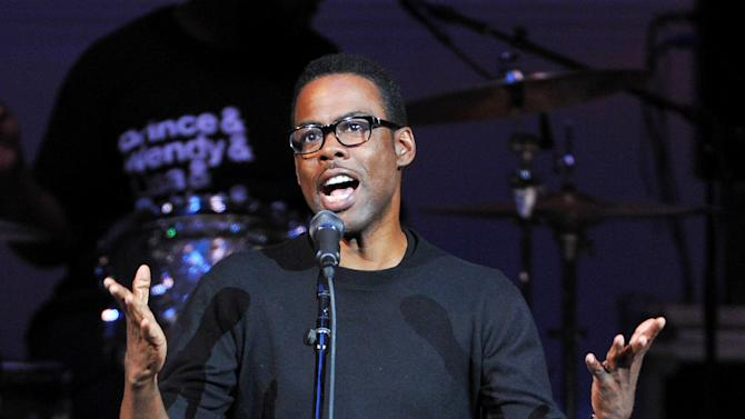 "Actor Chris Rock performs at ""The Music of Prince"" tribute concert at Carnegie Hall on Thursday March 7, 2013 in New York. (Photo by Evan Agostini/Invision/AP)"