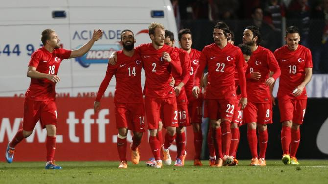 Turkey's players celebrate their second goal against Sweden during their international friendly soccer match at 19 Mayis Stadium in Ankara