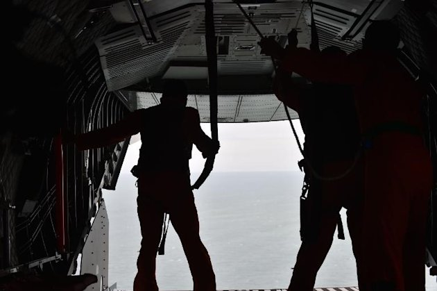 Indonesian Air Force crew members take part in the search and rescue operation for AirAsia Flight QZ8501 over waters near Pangkalan, Central Kalimantan