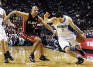 Orlando Magic shooting guard J.J. Redick (7) drives to the basket as Miami Heat's Shane Battier (31) defends during the first half of an NBA basketball game, Sunday, March 18, 2012, in Miami. (AP Photo/Lynne Sladky)