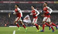 Britain Soccer Football - Arsenal v Hull City - Premier League - Emirates Stadium - 11/2/17 Arsenal's Alexis Sanchez celebrates scoring their first goal with teammates Reuters / Dylan Martinez Livepic