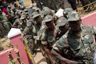 Soldiers queue to vote in Guinea Bissau's presidential elections in the capital, Bissau in March 2012. Guinea-Bissau troops staged a coup attempt late Thursday, attacking the prime minister's residence and taking over ruling party headquarters and the national radio station