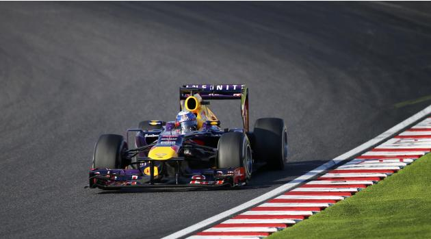 Red Bull Formula One driver Vettel of Germany races during the Japanese F1 Grand Prix at the Suzuka circuit