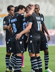 Lazio's German forward Miroslav Klose (2nd R) celebrates with his teammates after scoring against Pescara during their Italian Serie A football match at Pescara's Adriatico stadium. Lazio won 3-0