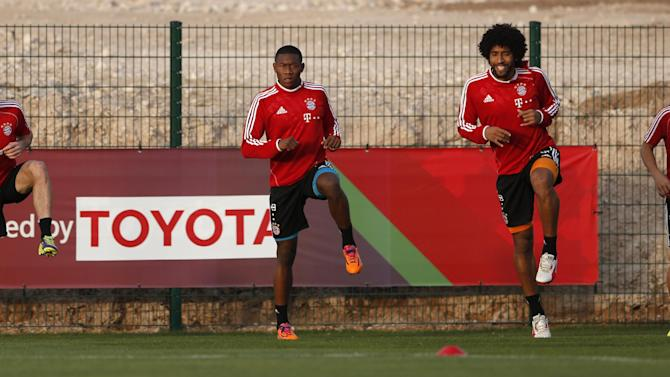 Bayern's Franck Ribery of France, from left, David Alaba of Austria, Dante and Rafinha of Brazil warm up during a training session at the Club World Cup soccer tournament in Agadir, Morocco, Sunday, Dec. 15, 2013. Bayern Munich will face Guangzhou Evergrande in the first semi final on Tuesday, Dec 17