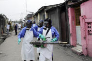 """FILE - In this Friday, July 22, 2016, file photo teams from MSF carry out fumigation efforts in the Yolo Sud neighborhood of Kinshasa, Democratic Republic of Congo, in a bid to kill the mosquitos that transmit yellow fever. The World Health Organization has declared an end to the yellow fever outbreak that killed about 400 people in Congo and Angola, calling it """"one of the largest and most challenging"""" in recent years. The outbreak, first detected in Angola in late 2015, caused 965 confirmed cases and thousands of suspected cases in both countries, the WHO said in a statement Tuesday, Feb. 14, 2017. (AP Photo/Jerome Delay, File)"""