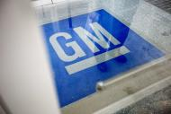 FILE - In this Thursday, Jan. 10, 2013 file photo, the logo for General Motors decorates the entrance at the site of a GM information technology center in Roswell, Ga. A congressional committee is investigating the way General Motors and a federal safety agency handled a deadly ignition switch problem in compact cars. House Energy and Commerce Committee Chairman Fred Upton of Michigan says the National Highway Traffic Safety Administration received a large number of complaints about the problem during the past decade. But GM didn't recall the 1.6 million cars worldwide until last month. (AP Photo/David Goldman, File)