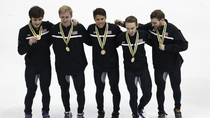 The U.S.' skating team poses during the medal ceremony after winning the men's 5000m relay final during the ISU Short Track World Cup speed skating competition in Shanghai