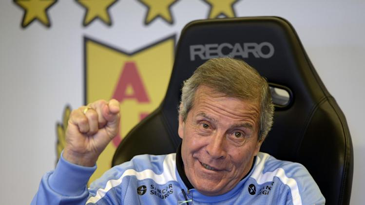 Uruguay's soccer head coach Oscar Tabarez gestures during a press conference on the outskirts of Montevideo, Uruguay, Wednesday, April 23, 2014. Uruguay will play in group D at the 2014 World Cup in June