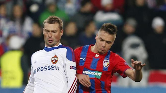 Viktoria Pilsen's Stanislav Tecl, right, challenges Moscow's Aleksei Berezutski, left, during their Champions League Group D soccer match between Viktoria Pilsen and CSKA Moscow in Pilsen, Czech Republic, Tuesday, Dec. 10, 2013