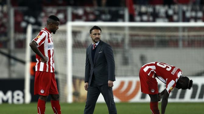 Olympiakos' head coach Vitor Pereira reacts after his team's defeat against Dnipro in their Europa League round of 32 second leg soccer match at Karaiskaki stadium in Piraeus