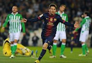 Barcelona forward Lionel Messi celebrates after scoring during his side's Spanish league match against Real Betis at the Benito Villamarin stadium in Sevilla on December 9, 2012. Barcelona coach Tito Vilanova on Tuesday said the secret Messi's success was that he still plays as if he was in the youth team