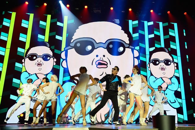 "Fans do ""Gangnam Style"" dance when they collect tickets. (Getty Images)"