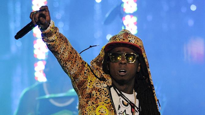 """FILE - In this March 1, 2012 file photo, Lil Wayne performs at the Caesars Entertainment """"Escape To Total Rewards"""" concert, in Los Angeles.  Lil Wayne's """"Love Me"""" tops the most viral tracks for Spotify for the USA from Monday, Jan. 21, to Sunday, Jan 27, 2013, via Facebook, Tumblr, Twitter and Spotify.  (AP Photo/Chris Pizzello, File)"""