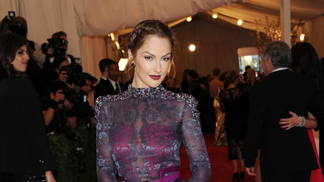 """Minka Kelly attends The Metropolitan Museum of Art's Costume Institute benefit celebrating """"PUNK: Chaos to Couture"""" on Monday, May 6, 2013, in New York. (Photo by Evan Agostini/Invision/AP)"""
