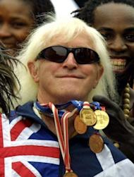 File picture from 2002 of Jimmy Savile. An inquiry into the BBC's culture and practices begins a year to the day since the death of Savile, the eccentric presenter now considered one of the most prolific sex offenders in British history, with some 300 alleged victims coming forward in recent weeks