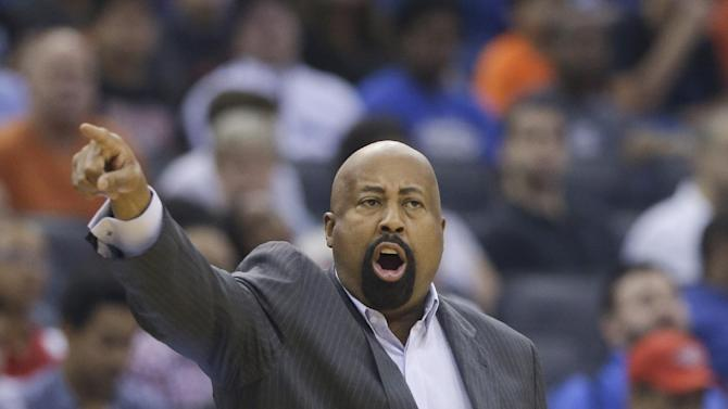 New York Knicks head coach Mike Woodson directs his players against the Orlando Magic in the first half of an NBA basketball game in Orlando, Fla., Monday, Dec. 23, 2013
