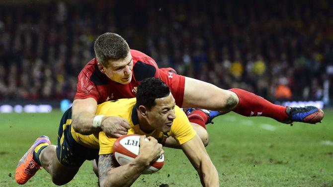 Australia's Folau narrowly fails to score a try as he is tackled by Wales's Williams during their international rugby union match in Cardiff