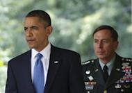 US President Barack Obama (L) and General David Petraeus make their way to the Rose Garden at the White House for a statement by Obama in 2010. The FBI uncovered the affair that led to the resignation of Petraeus while investigating threatening emails sent by his lover to a second woman, US media reported Sunday