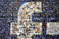 A collage of profile pictures makes up a wall in the break room at the new Facebook Data Center on April 19, 2012 in Forest City, North Carolina. Facebook moved closer toward its hotly anticipated share offering Thursday, setting a price range that values the social network below some expectations but establishes it as one of the most valuable tech firms