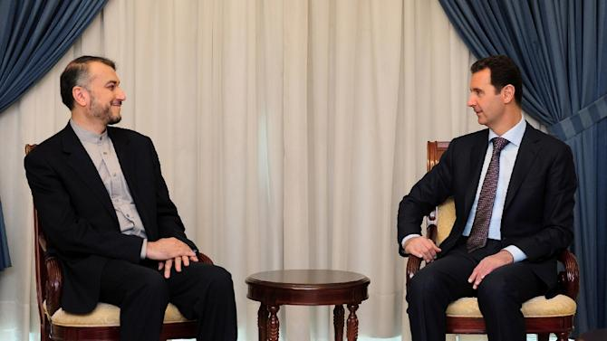Picture released by the Syrian Arab News Agency (SANA) shows Syrian President Bashar al-Assad (R) meeting with Hussein Amir-Abdollahian, Iran's deputy foreign minister for Arab-African Affairs, on September 3, 2015 in Damascus