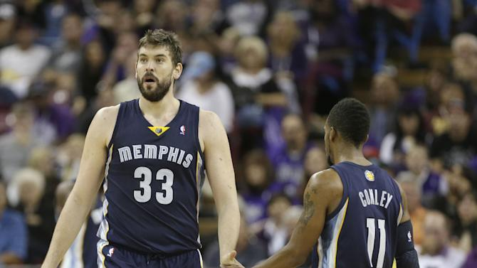 Memphis Grizzlies center Marc Gasol, left, of Spain, is congratulated by teammate Mike Conley after scoring late in the fourth quarter of an NBA basketball game in Sacramento, Calif., Sunday, Nov. 17, 2013. The Grizzlies won 97-86