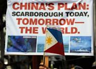 Anti-China protesters are pictured during a rally in front of the Chinese embassy in the financial district of Manila, on May 11. Hundreds of Filipinos came to demonstrated over an escalating territorial row, with the protesters denouncing China's rulers as arrogant bullies