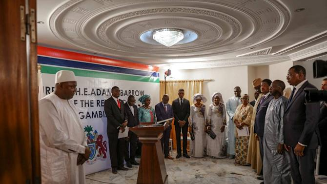 Officials gather at the inauguration ceremony of Gambia President Adama Barrow  at the Gambian embassy in Dakar