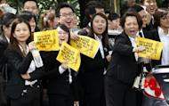 Malaysian lawyers hold placards as they shout slogans during a protest in Kuala Lumpur, Malaysia, Tuesday, Nov. 29, 2011. Hundreds of Malaysian lawyers staged a rare protest march Tuesday demanding that the government abandon plans for a law that will forbid street rallies. (AP Photo/Lai Seng Sin)