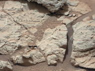 "This image of an outcrop at the ""Sheepbed"" locality, taken by NASA's Curiosity Mars rover with its right Mast Camera (Mastcam), shows show well-defined veins filled with whitish minerals, interpreted as calcium sulfate. Image released Jan. 15,"