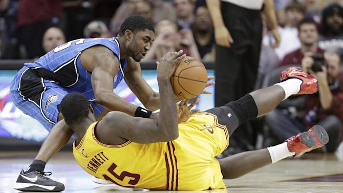 Orlando Magic's E'Twaun Moore, top, and Cleveland Cavaliers' Anthony Bennett, from Canada, battle for a loose ball during the fourth quarter of an NBA basketball game Thursday, Jan. 2, 2014, in Cleveland. The Cavaliers won 87-81