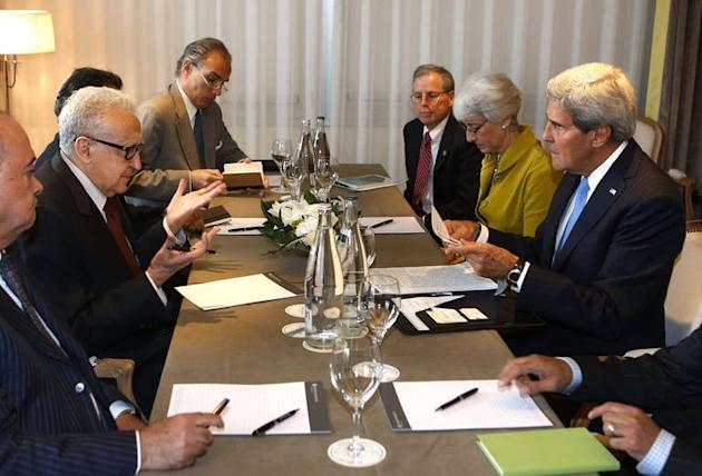 US Secretary of State John Kerry (R) meets with UN Special Representative for Syria Lakhdar Brahimi (2nd L) in Geneva on September 12, 2013