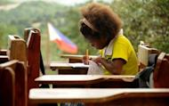 An Ayta student works in a classroom at the Camias Resettlement Elementary School in Porac, near Manila, on February 14. Spoken by just 3,000 people in the hills northwest of Manila, Ayta Magindi is one of several dozen of endangered languages in the Philippines