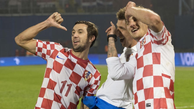 ZAGREB, Nov. 20, 2013 (Xinhua/IANS) -- Darijo Srna (L), Mario Mandzukic (C) and Nikica Jelavic of team Croatia pose after their 2014 World Cup qualifying second leg playoff soccer match against Iceland in Zagreb, Croatia, on Nov. 19, 2013. Coatia won 2-0 in total to be qualified for the final stage of the 2014 World Cup. (Xinhua/Miso Lisanin)