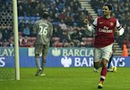 Arsenal's Mikel Arteta (R) celebrates after scoring during the Premier League match against Wigan on December 22, 2012. Arsenal climbed to third place in the Premier League as Arteta's second half penalty sealed a 1-0 win over Wigan