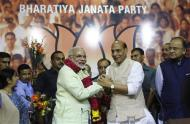 India's Hindu nationalist Narendra Modi (center L) is congratulated by Rajnath Singh (center R), president of India's main opposition Bharatiya Janata Party (BJP), after Modi was crowned as the prime ministerial candidate for the BJP at the party headquarters in New Delhi September 13, 2013. REUTERS/Anindito Mukherjee