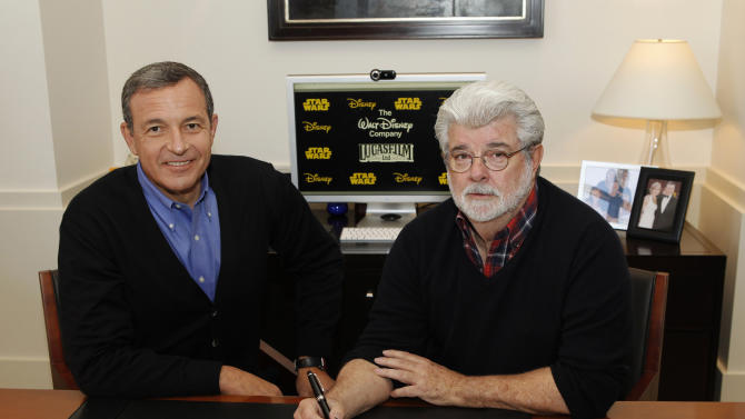 In this publicity photo released by Disney, Robert A. Iger, left, chairman and CEO, The Walt Disney Company, and George Lucas, chairman and founder, Lucasfilm, sign the agreement for The Walt Disney Company to acquire Lucasfilm Ltd. on Tuesday, Oct. 30, 2012, in Burbank, Calif.  The Walt Disney Co. announced today that it was buying Lucasfilm Ltd. from George Lucas for $4.05 billion. The deal brings Lucasfilm under the Disney banner with other brands including Pixar, Marvel, ESPN and ABC, all companies that Disney has acquired over the years. (AP Photo/Disney, Rick Rowell)