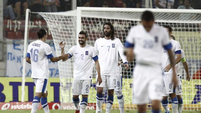 Greece's players celebrate a goal against Slovakia during their 2014 World Cup qualifying soccer match in Athens