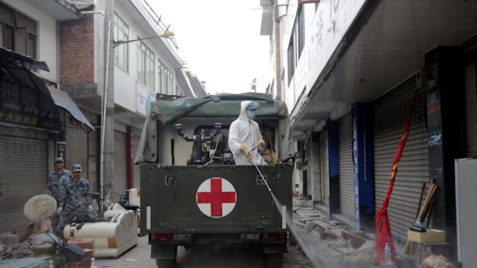 A soldier disinfects the streets in Lushan county in southwestern China's Sichuan province Monday, April 22, 2013. The efforts under way in the mountainous province after a quake Saturday that killed nearly 200 people showed that the government has continued to hone its disaster reaction since a much more devastating earthquake in 2008, also in Sichuan, and another one in 2010 in the western region of Yushu. (AP Photo) CHINA OUT