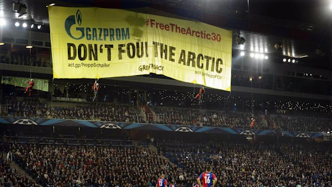 "FILE- In this Tuesday, Oct. 1, 2013, Greenpeace activists display a banner calling for protection of the Arctic region, during a Champions League group E group stage soccer match between Switzerland's FC Basel and Germany's FC Schalke 04 at the St. Jakob-Park stadium in Basel, Switzerland. The Swiss soccer club Basel has been fined $41,000 for Greenpeace's protest at its stadium during a Champions League game against Schalke. European soccer's governing body says Basel was penalized for ""insufficient organization"" at the Oct. 1 match. Host clubs are responsible for security at stadiums and ensuring matches run smoothly"