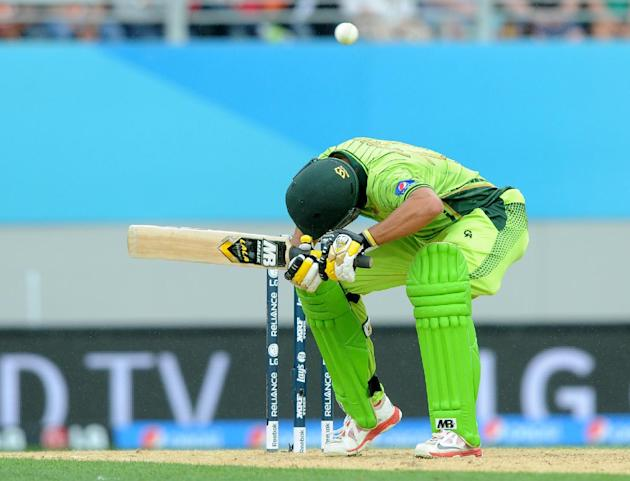 Pakistan's Shahid Afridi ducks under a bouncer while batting against South Africa during their Cricket World Cup Pool B match in Auckland, New Zealand, Saturday, March 7, 2015. (AP Photo/Ross Setf