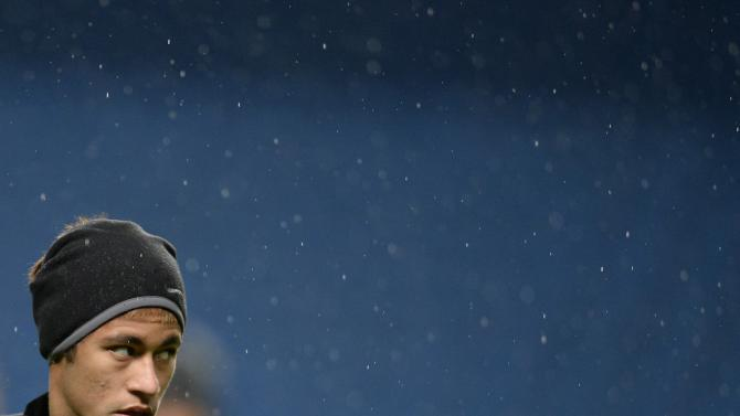 Barcelona's Neymar stands in the rain during a training session at the Etihad Stadium in Manchester